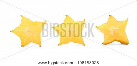 Three cut carambola fruit, isolated on a white background. Star shaped pieces full of vitamins for light breakfast. Whole carambola fruit for cocktails. Tropical and exotic fruits. Copy space.