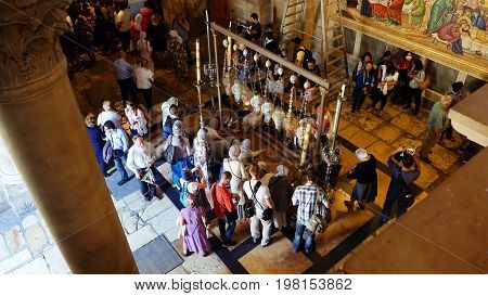 Jerusalem, Israel - May 25, 2017: Prayers at the Stone of Anointing in the Holy Sepulcher Church in Jerusalem. The Church and Empty Tomb the most sacred places for all Christians people in the world.