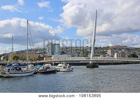 Pedestrian bridge and boats in Swansea Harbour
