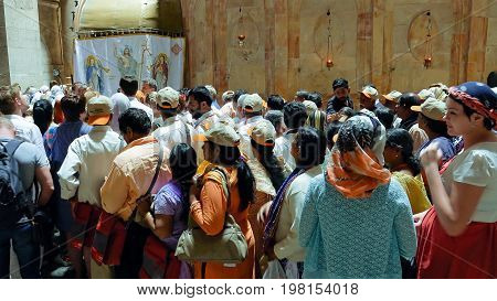 Jerusalem, Israel - May 25, 2017: People are waiting in a line to enter into Jesus Empty tomb in Jerusalem in the Holy Sepulcher Church. The Church and Empty Tomb the sacred places for all Christians.