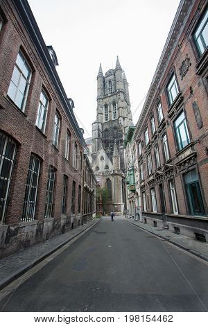 Ghent Belgium - June 26 2011: Small road to Ghent cathedral