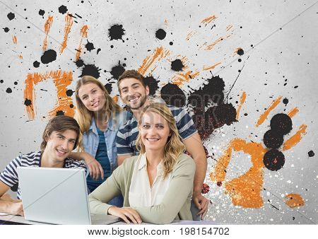 Digital composite of Happy young students using a computer against grey, yellow and black splattered background
