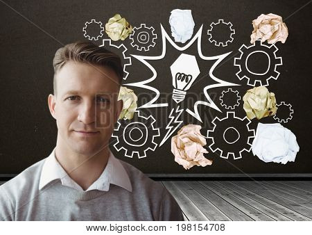 Digital composite of Man standing next to light bulb with crumpled paper balls in front of blackboard