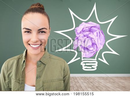 Digital composite of Woman standing next to light bulb with crumpled paper ball in front of blackboard