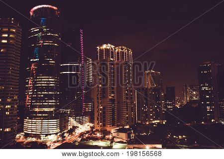 Spectacular night city view. Kuala Lumpur skyscrapers, Malaysia. Business metropolis. Modern buildings. Luxurious travel and tourism. Urban cityscape. Metropolitan architecture. Nighttime street