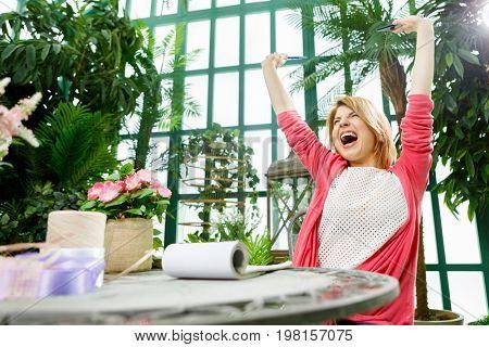 Cheerful florist in flower shop