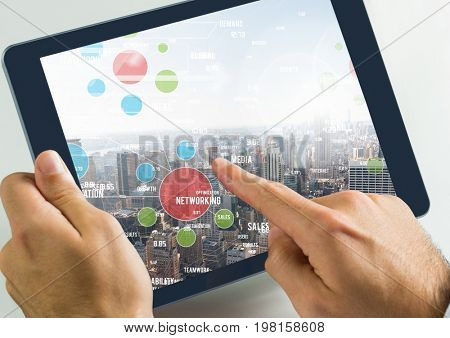 Digital composite of Holding tablet and city with icons connections