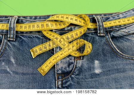 Blue Jeans With Yellow Measure Tape Instead Of Belt