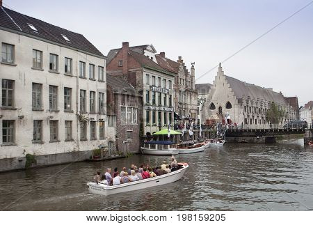 Ghent Belgium - June 26 2011: Sightseeing boat tour on Ghent canal