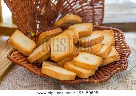 Baked small slices of bread in a basket.