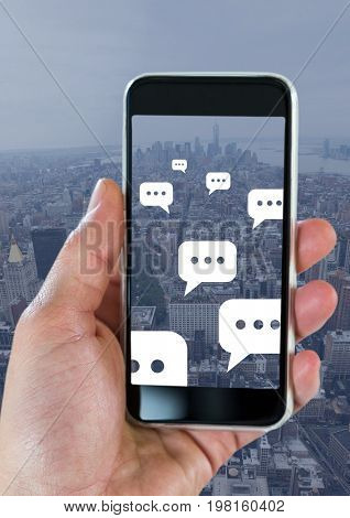 Digital composite of Holding phone and Chat bubble icons over city