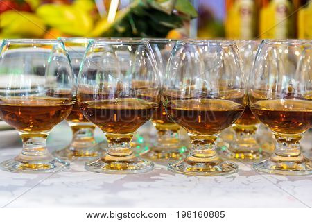 Glasses of brandy or cognac and bottle.