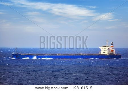 Ship in the sea on stormy day.