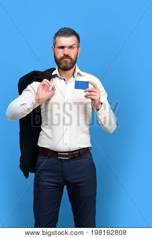 Guy With Grumpy Face And Glasses Isolated On Blue Background