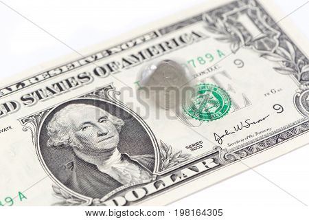 Motion spinning China coin on one US dollar bill on white background Chinese and USA economy finance concept.