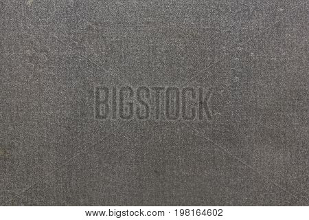 Flat texture of dirty porous gray fabric