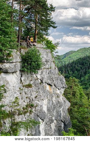 TOMASOVSKY VYHLAD SLOVAKIA - JUN 3: Tourists sitting on the rock at viewpoint in Slovak paradise on Jun 3 2017 in Tomasovsky vyhlad