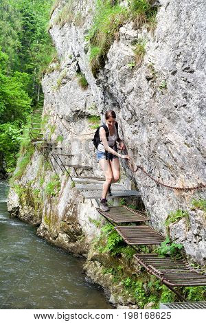 Hiking woman in climbing trail in Slovak paradise