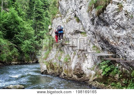 Hikers on climbing trail in Slovak paradise