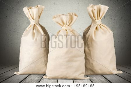 Three bags money isolated close storage brown