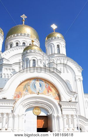 Closeup of ancient Russian Cathedral in Diveevo city against blue sky
