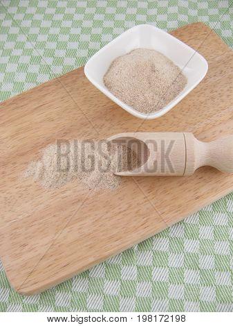 Psyllium seed husk powder on a wooden board