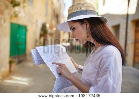 travel guide, tourism in Europe, woman tourist with map