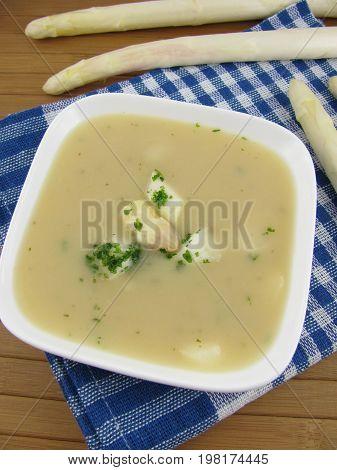 Fresh asparagus cream soup in a soup plate