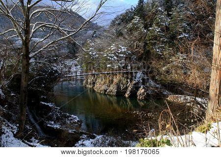 A conduit crosses a river in Shirakawago