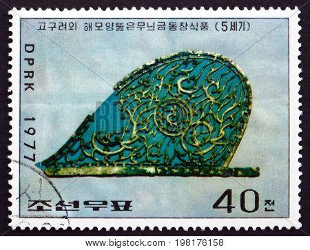 NORTH KOREA - CIRCA 1977: a stamp printed in North Korea shows Gold-copper Ornament Koguryo Dynasty Korean Cultural Relic circa 1977
