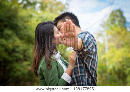 The Man's Hand Concealed While He Kissed The Girl On A Forest Road.