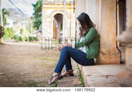 Depressed Women. Asian Beautiful Girl Sits Sadly On The Cement Floor In Ancient Houses.