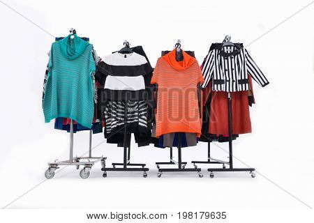Variety row of three colorful female clothing on hanging