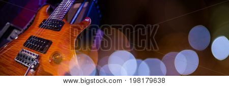Digital composite of Electric guitar with blue lights
