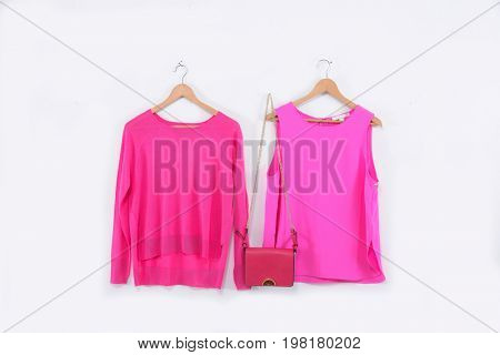 Female pink and red shirt dress with handbag on a hanger