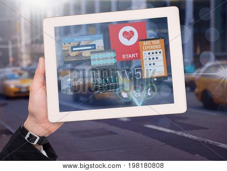 Digital composite of Holding tablet and City with app interfaces