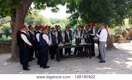Krka National Park, Croatia - June 24, 2017: Male choir sings in Krka National Park, Croatia