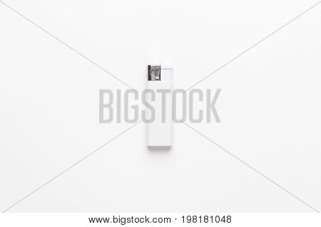 blank gas sigarette lighter on white background. blank gas sigarette lighter not isolated. blank gas sigarette lighter mockup design template. white sigarette lighter central composition