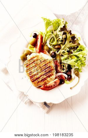 Grilled turkey breast fillet with fresh salad