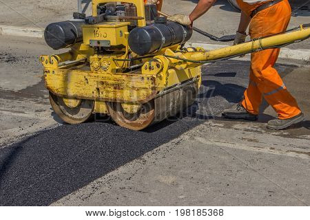 City Crew Installing Asphalt Speed Bump