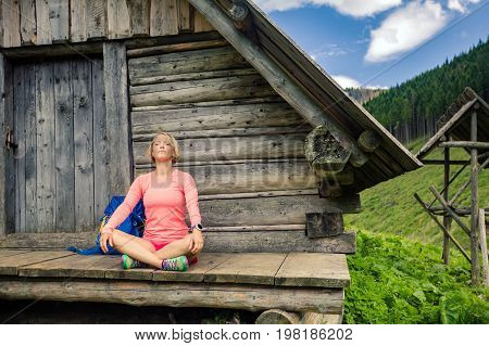 Young woman hiker camping and relaxing in beautiful Tatra mountains on hiking trip. Inspirational landscape in Poland. Active person resting outdoors in summer nature.