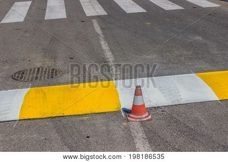 Freshly Painted Crosswalk And Speed Bump 2