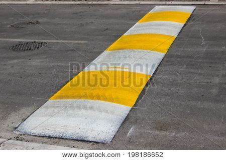 Freshly Painted Speed Bump For Slowing Traffic Near School
