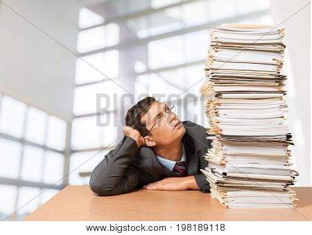 Heap man papers business issues business person human