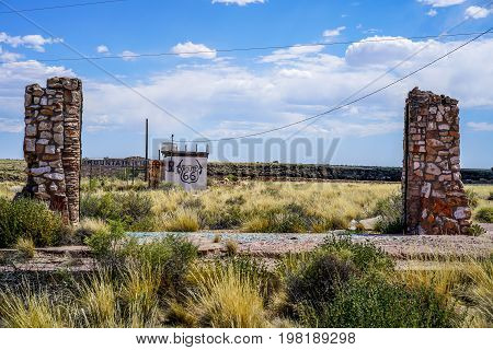 A ghost town in the Arizona desert, abandoned for over thirty years. It was once a thriving town on a historic route and now it sits in ruins crumbling from nature's wrath.