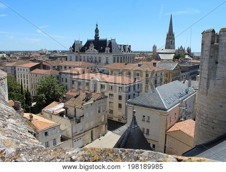 Rooftop view of the historic town of Niort, its Town Hall, and the spire of Notre Dame Church. Niort is a large town in the Deux-Sevres department in western France.