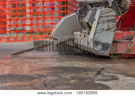 Close Up Of Cutting Asphalt Road With Diamond Saw Blade