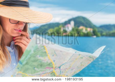 Tourist with a map enjoying the summertime.