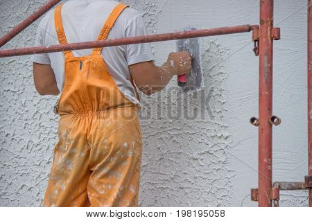 Plasterer Applying A Finish Coating To A Wall 2