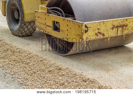 Yellow Vibratory Steel Drum Compactor During Road Construction